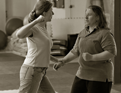 Woman practicing self defense